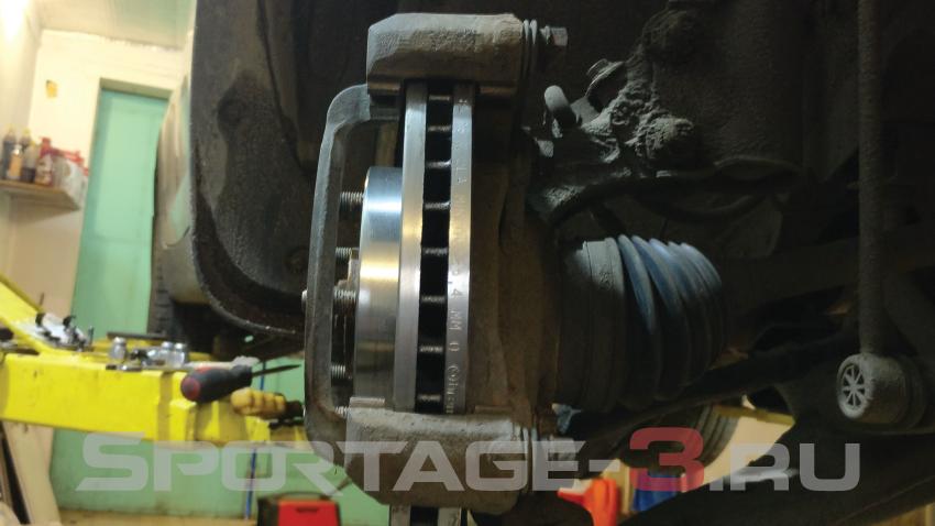 замена передних тормозных дисков на kia sportage 3